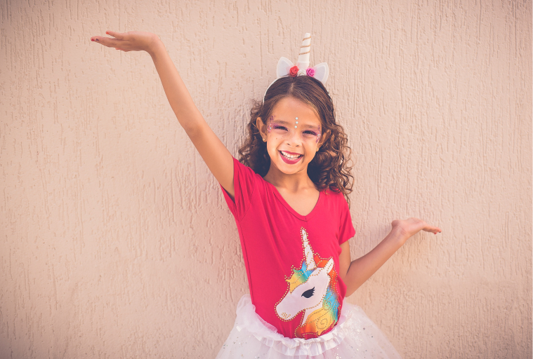 Girl wearing pink unicorn outfit. Ballroom for kids at Brooklyn dance lessons